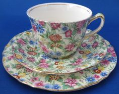 This is a vintage Royal Winton Grimwades, England cup and saucer with matching plate or teacup trio in the Kew Chintz pattern made in the 1950s. The cup is 2.6 inches high, the saucer is 5.5 and the p