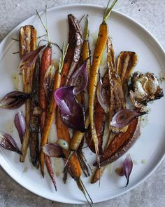 Maple-mustard roasted root vegetables get nice and caramelized for a sweet and tangy Thanksgiving side dish.