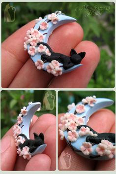 "Mondkatze 13: Hallie by Talty (Mexico): ""This was a commission for my sister, her friend is away for a year and she loves her cat Hallie deeply. All handmade with polymer clay, the flowers were cut with a tiny cutter, shaped to look like cherry blossoms and the center was painted with a light pink wash. Everything is handmade by me, no molds or premades were used."""