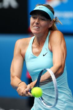 Maria Sharapova - Australian Open: Day 8.  Maria Sharapova of Russia plays a backhand in her fourth round match against Dominika Cibulkova of Slovakia during day eight of the 2014 Australian Open at Melbourne Park on January 20, 2014 in Melbourne, Australia.