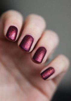 A beautiful Burgundy Red nail. Almost like a Black Cherry with Gold undertones. Some glitter of the same color