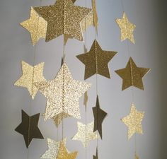 Hey, I found this really awesome Etsy listing at https://www.etsy.com/listing/186199531/gold-glitter-star-garland-glitter
