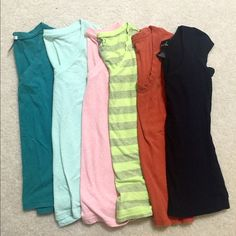 Basic top bundle! Have A look at this steal! This bundle includes six tops, five V-neck's and one crewneck (black top is a crew neck). I am only selling these as a bundle since I just want them gone from my closet...  The tops ranges from target, to wet seal!  All of these are a size small!  I'm selling all 6 tops for $22 price is firm.  Take advantage of my 15% sale on all bundles ends March 20 Mossimo Supply Co. Tops Tees - Short Sleeve
