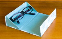 BOX AND NEEDLE blog  Expanded ideas: I'd put sheered elastic encased top edge fabric @ 3/4, or paper across 1/2 way to further contain the glasses from falling out Cardboard Paper, Cardboard Crafts, Paper Crafts, Fabric Boxes, Cute Box, How To Make Box, Origami Box, Craft Box, Diy Box