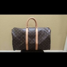 Authentic Louis vuitton keepall 45 made in France From 2006...absolutely authentic.  Some water marks to vachetta but in excellent condition for age.  message me for more pics.  Price is firm on posh..sorry no trades..Also listed on ebay..will negotiate thru pypl Louis Vuitton Other