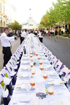 Final touches put on the table before guests make their way to their seats at Project Dinner Table event at Town Square Las Vegas