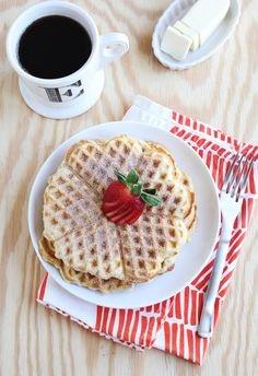 Snickerdoodle Waffles.  Notes: don't be too stingy when filling the iron. Don't worry about the runny batter - it fluffs up.