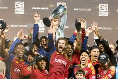 Real Salt Lake players celebrate their win over the Portland Timbers, MLS soccer Sunday November 24, 2013, in Portland.