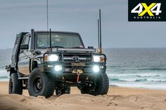 Tough on the outside, comfortable on the inside, and wholly capable underneath, this custom Toyota 'Thug Truck' is all show and all go. Landcruiser Ute, Landcruiser 79 Series, Toyota Lc, Toyota Hilux, 4x4 Trucks, Diesel Trucks, Toyota Cruiser, Land Cruiser 80, Good Looking Cars
