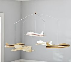 Airplane Mobile #pbkids This thing is ginormous!!! We're going to take the planes off it and hang them in a grouping instead...