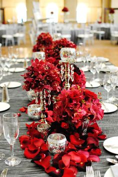 Red, Silver, White & Black Wedding Inspirations. Red flowers down the center of the table with silver tablecloth and silver candles