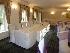 Yellow & Dark Purple organza sashes/table runners, combined with our Fabulous top table Mr & Mrs Letter Lights.