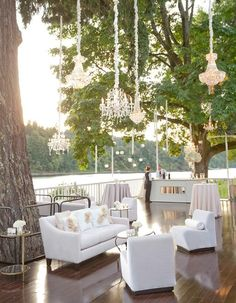 This gorgeous white-on-white lounge area will give your guests a stylish relaxation zone at your reception!
