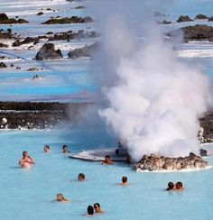 Blue lagoon geothermal spa. grindavík, iceland.    The Blue Lagoon geothermal spa is one of the most visited attractions in Iceland. The steamy waters are part of a lava formation.