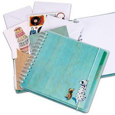 Organiser Book - Keep track of your life with this compact 'Rolo & Midge' organiser book. The 12 pocket dividers will help keep all your essential bits and pieces together. Jot down any reminders, dates, ideas etc on the 60 sheet notepad. To order please go online at www.phoenix-tradi... or send me a message.