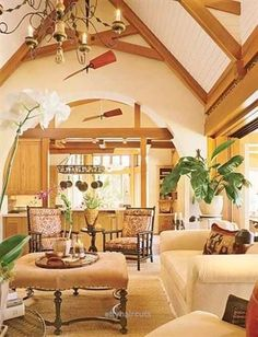 British Colonial Design: High ceilings and fans with wide blades are commonplace in British Colonial decor. Notice the plantation chairs with their sloped backs and low seats. This design symbolizes West Indies style. Hawaiian Home Decor, Hawaiian Homes, Tropical Home Decor, Tropical Houses, Tropical Interior, Coastal Decor, Tropical Furniture, Tropical Plants, Coastal Living