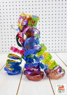 Plastic Bottle Sculpture inspired by Dale Chihuly. A beautiful child led process art activity using plastic bottles. Recycled Art Projects, Projects For Kids, Spring Art, Spring Crafts, Mobiles, Recycling For Kids, Recycling Ideas, Fun Crafts, Crafts For Kids