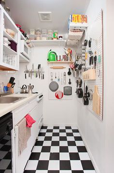 Way to make a tiny kitchen work.  Like the all white and then the checked floor.
