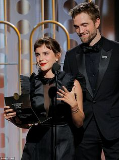 Then and now: 'Teenage me is losing her g*****n mind at Emma Watson and Robert Pattinson presenting an award together' wrote one user