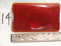 "Red Automobile Tail Light Lens #T338RQRL 4-3/16"" X 2-3/8"" X 1/2"" 1/16"" lip"