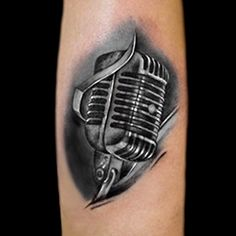 Realistic microphone tattoo done in black and grey by Brandon Marques. Timeless Tattoo Studio, Toronto, ON. For appointments and info visit our website or email: info@timelesstattoos.ca.