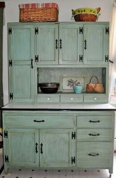 Love this hoosier cabinet...I have this exact hoosier cabinet but is unfinished and hardware is different...looking for inspiration for colors...maybe this one?