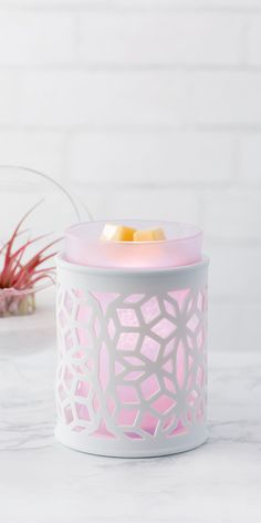A new warmer from the Spring/Summer catalog! So simple and pretty. The middle can be changed and comes in different colors. So far purple and blue. Both work with any decor :)