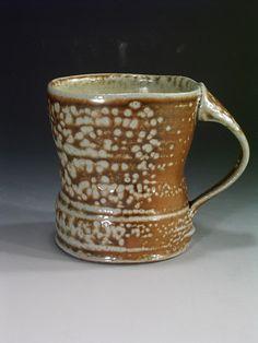 This mug reminds me of the forms of Bernard Leach.   Sandy Lockwood (Australia)  |  Stoneware mug.
