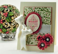 10-31-12.  RECIPE:  Stamps: Waltzingmouse Stamps- Compliments of the Season 2  Paper: Neenah Classic Crest Cream 80lb, Authentique – Merry  Ink: Colorbox – Chianti  Accessories: Spellbinders™ Classic Ovals SM,Spellbinders™ Floral Ovals, Spellbinders™ Jewel Flowers and Flourishes, Satin Ribbon, Recollections Pearls