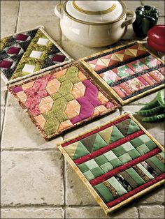 All in a Row -- These quilted pot holders are easy and fun ways to clean out your scrap fabric collection.