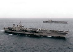 uss constellation | the uss constellation cv 64 foreground steams alongside the uss kitty ...