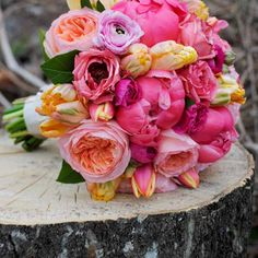 Southern Blooms, Bridal bouquet of coral charm peonies, peach parrot tulips, Juliet Garden Roses, Ranunculus