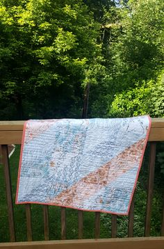 31 x 31 in square quilt, cotton and light blues birds with roses, fathers and soft prints, Machine quilted with roses and lines throughout. Wall hanging or table topper size. Outdoor Tables, Outdoor Decor, Family Crafts, Table Toppers, Square Quilt, Machine Quilting, Blue Bird, Roses, Birds