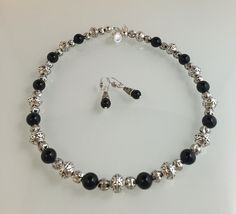 Onyx stone, bali style beads, pewter with SS overlay beads and magnetic clasp.