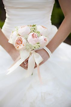 bride with rose bouquet 275x412 English Garden Wedding Inspiration