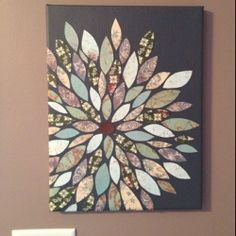 Easy DIY Scrapbook paper wall art, (I can see this done with other materials as well)