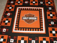 Harley Davidson center, piano key border, 9 patch blocks with a Harley logo square in the middle of each.