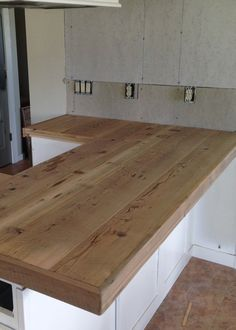 DIY Reclaimed Wood Countertop - adding trim boards along edge