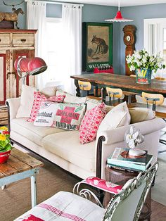How fun is this room?? Flea Market Decor. Feed sack pillows paired with bold modern prints.