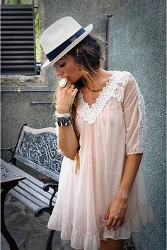 The accessories such as the light fedora and chunky bracelettes make the outfit a real fashion statement. I love the short light pink lacey dress as well!