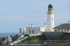 https://flic.kr/p/LRKR2b   Douglas Head Lighthouse, Isle of Man, U.K.   Built in 1892 and designed by David and Thomas Stevenson of the famous Scottish family of lighthouse builders (and also including author Robert Louis Stevenson).  The round, masonry tower is 66 feet tall and painted in the white, mustard and black colors of Scotland's Northern Lighthouse Board, which is responsible for all the Isle of Man lighthouses. There is a one-story keeper's house nearby, painted white with…