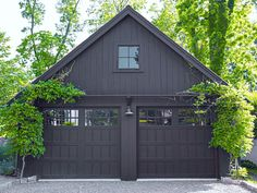 Trends We Love: Dark Exteriors | Studio McGee.  All Black garage.