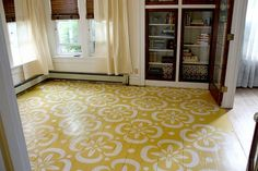 I have always wanted try this, but I tend to forget about it!  If you have a wood floor that needs some TLC and you want to make it look better yourself then you can paint it!!  Some paint solid colors or you can even paint a design like these shown.!