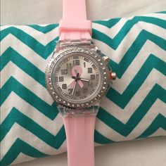 **SALE!!** Breast Cancer Awareness Watch Geneva Breast Cancer Awareness watch. Stainless steel back, silicone band, battery is brand new and working. Has never been worn-BNWOT! Geneva Accessories Watches