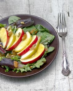 Apples and pears grace this spinach salad with a flavorful curry vinaigrette and golden raisins. A perfect winter or fall salad.