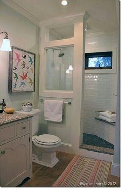 Half wall with OPEN door to shower.  No shower door at all?? Keep toilet where it is