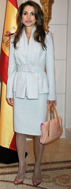 Rania in powder blue suit with Prada bag and Prada shoes.