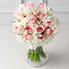 A sweet spring selection of gorgeous pink roses complimented by delicate white spring scented narcissus all hand arranged into the perfect spring gift. #flowers #pink #white #SS14