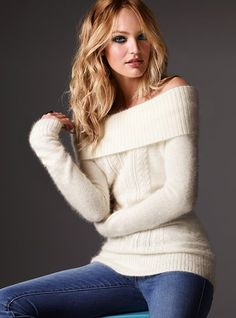 Angora Tunic Sweater    Wrap yourself up in something extra soft and special. Knit from luxurious angora wool, this slim-fitting, sexy tunic features a wide neck that can be worn on or off the shoulder for two equally eye-catching looks. As soon as you put it on you'll get that warm fuzzy feeling that means true love.  Can be worn on or off the shoulder  Slim fit  Imported angora/nylon