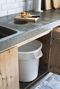 Concrete kitchen counter/compost/garbage cut out/sink base/oak cabinet/Scribe Winery in Napa Valley Photography by Andres Gonzalez for Remodelista (scheduled via http://www.tailwindapp.com?utm_source=pinterest&utm_medium=twpin&utm_content=post152472719&utm_campaign=scheduler_attribution)
